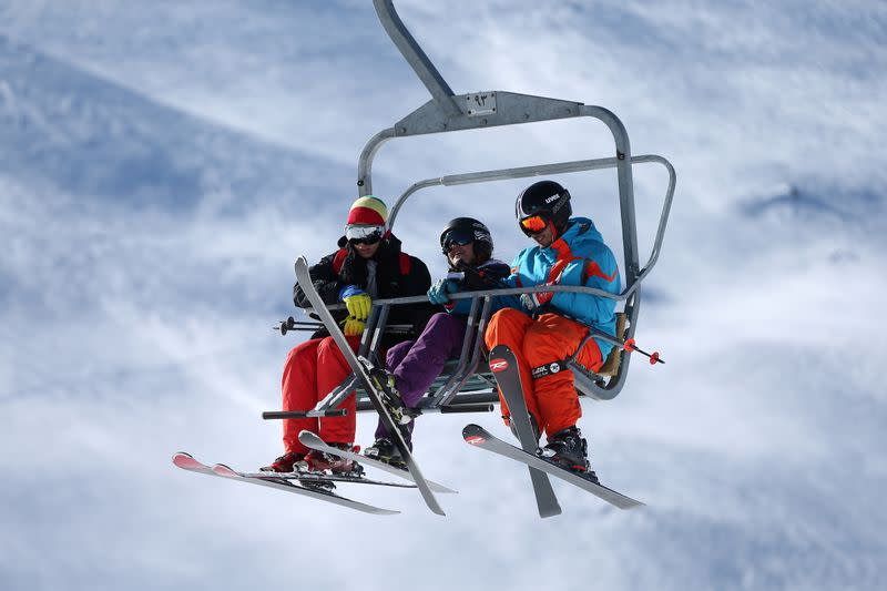 FILE PHOTO: Iranian skiers sit at chairlift at the Tochal ski resort, in north of Tehran