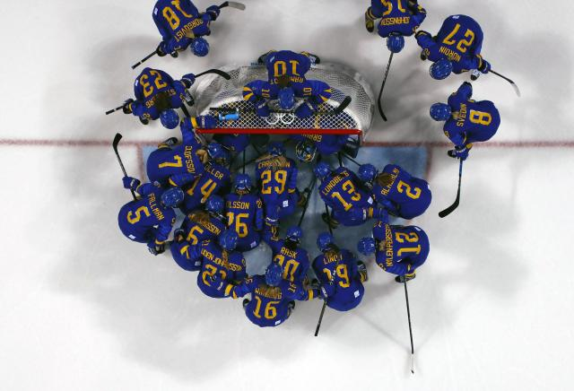 Ice Hockey - Pyeongchang 2018 Winter Olympics - Women's Quarterfinal Match - Finland v Sweden - Kwandong Hockey Centre, Gangneung, South Korea - February 17, 2018 - Team Sweden gather near their net before a game against Finland. REUTERS/David Cerny