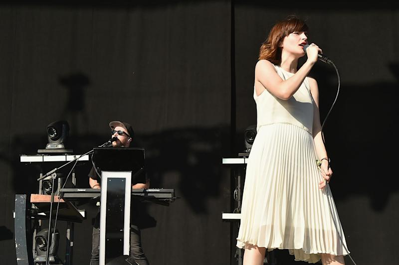 Recording artist Lauren Mayberry (L) and Martin Doherty of Chvrches performs onstage at Firefly Music Festival on June 18, 2016 in Dover, Delaware. Credit: Theo Wargo/Getty Images for Firefly