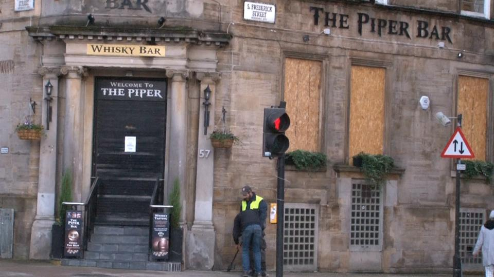 Boards put up on the windows of The Piper Bar shortly after the 6pm curfew, in Glasgow, as pubs and licensed restaurants in five health board areas across central Scotland have begun their enforced 16-day closure amid new restrictions in a bid to curb the spread of coronavirus.