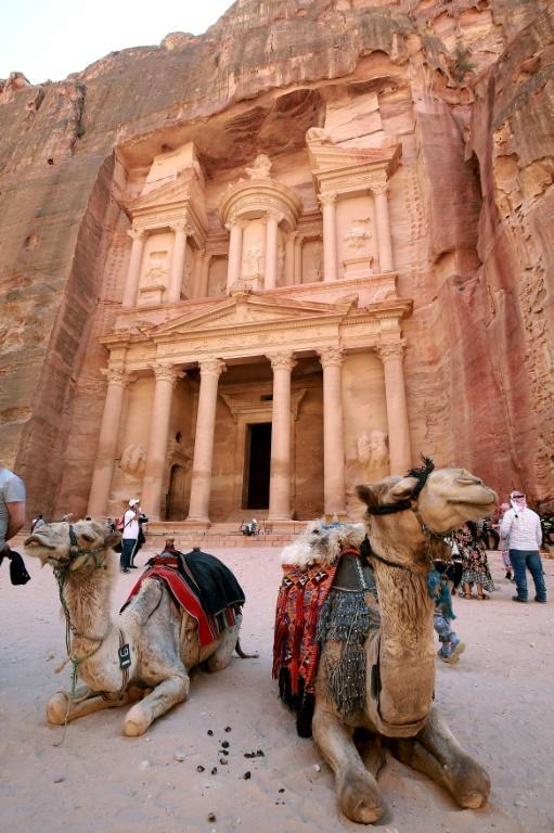 Camels sit in front of the Treasury, in Jordan's ancient city of Petra, a UNESCO World Heritage site