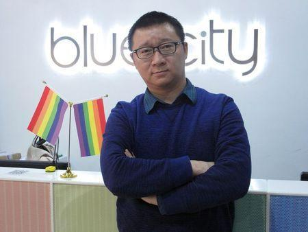 Ma Baoli, founder of Blue City, parent company of Chinese gay dating app Blued, poses for pictures at his office reception area in Beijing, January 7, 2015. REUTERS/Guo Yeqi