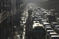 Traffic builds up near a checkpoint during a stricter lockdown as a precaution against the spread of the new coronavirus disease at the outskirts of Marikina City, Philippines on Friday, August 6, 2021. Thousands of people jammed coronavirus vaccination centers in the Philippine capital, defying social distancing restrictions, after false news spread that unvaccinated residents would be deprived of cash aid or barred from leaving home during a two-week lockdown that started Friday. (AP Photo/Basilio Sepe)