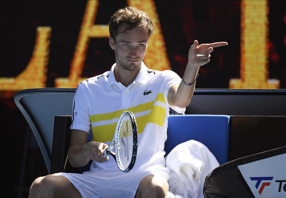 Russia's Daniil Medvedev gestures after defeating Serbia's Filip Krajinovic in their third round match at the Australian Open tennis championship in Melbourne, Australia, Saturday, Feb. 13, 2021.(AP Photo/Andy Brownbill)