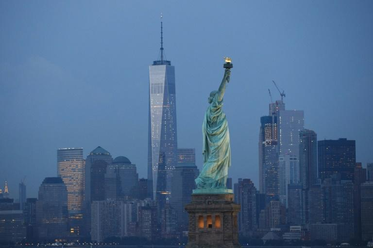 The skyline of New York City with the Statue of Liberty in the foreground