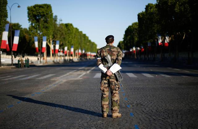 <p>A French soldier waits on the Champs Elysees avenue before Bastille Day parade in Paris, Friday, July 14, 2017. (Photo: Kamil Zihnioglu/AP) </p>