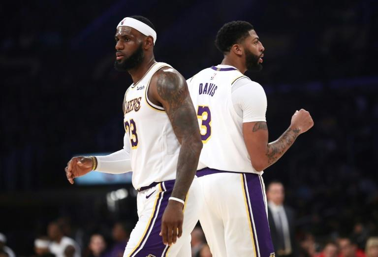 Star power: The Los Angeles Lakers look set to contend in the upcoming NBA season with LeBron James and Anthony Davis -- seen here in a pre-season game against the Golden State Warriors (AFP Photo/Sean M. Haffey)