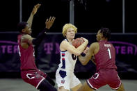 Liberty's Drake Dobbs, center, is pressured by South Carolina's Keyshawn Bryant, left, and T.J. Moss (1) during the second half of an NCAA college basketball game Saturday, Nov. 28, 2020, in Kansas City, Mo. (AP Photo/Charlie Riedel)