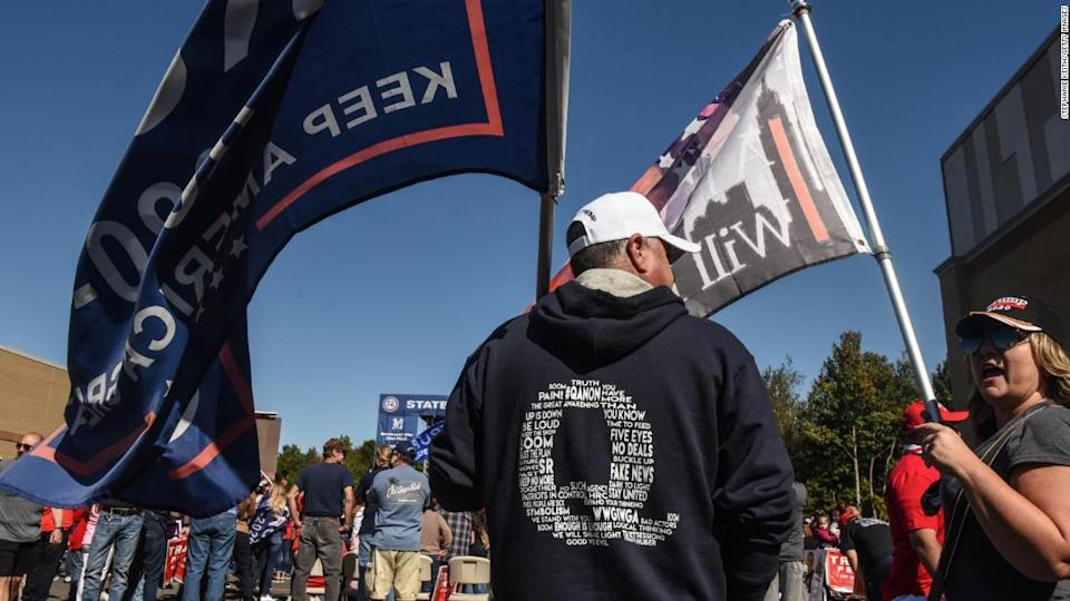 """<p>A man wears a QAnon sweatshirt during a pro-Trump rally on October 3, 2020 in the borough of Staten Island in New York City. The event was held to encourage supporters to pray for Trump's health after he contracted Covid-19.</p><div class=""""cnn--image__credit""""><em><small>Credit: Stephanie Keith/Getty Images / Getty</small></em></div>"""