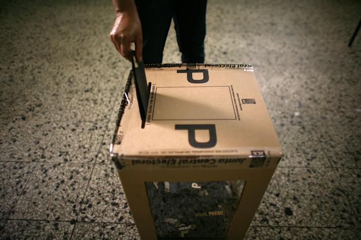 A voter casts his ballot during the presidential election in Santo Domingo, Dominican Republic, Sunday, May 20, 2012. (AP Photo/Ricardo Arduengo)