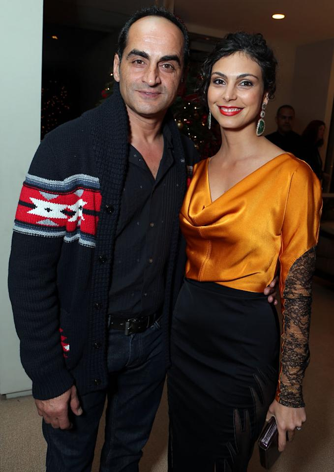 Navid Negahban and Morena Baccarin at Showtime's 7th Annual Holiday Soiree on December 3, 2012 in Beverly Hills, California.