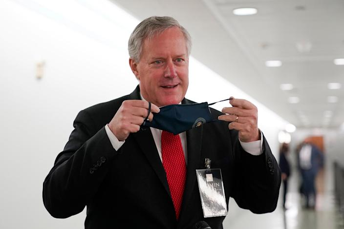 Donald Trump claims his chief of staff, Mark Meadows, insisted on riding in Marine One after the president got coronavirus. (AP Photo/J. Scott Applewhite)