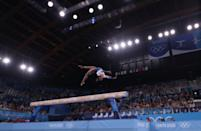 <p>TOKYO, JAPAN - AUGUST 03: (EDITORS NOTE: Image was created using a variable planed lens.) Simone Biles of Team United States in action during the Women's Balance Beam Final on day eleven of the Tokyo 2020 Olympic Games at Ariake Gymnastics Centre on August 03, 2021 in Tokyo, Japan. (Photo by Laurence Griffiths/Getty Images)</p>