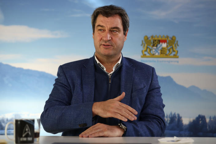 Bavarian state governor Markus Soeder attends an Associated Press interview in Nuremberg, Germany, Thursday, Feb. 18, 2021. Markus Soeder is many things: state governor of Bavaria, Star Trek fan, a conservative for whom combating climate change is an article of faith. The question Germans are asking now is: can the 54-year-old win enough backing across the political spectrum to succeed Angela Merkel as chancellor in September. (AP Photo/Matthias Schrader)