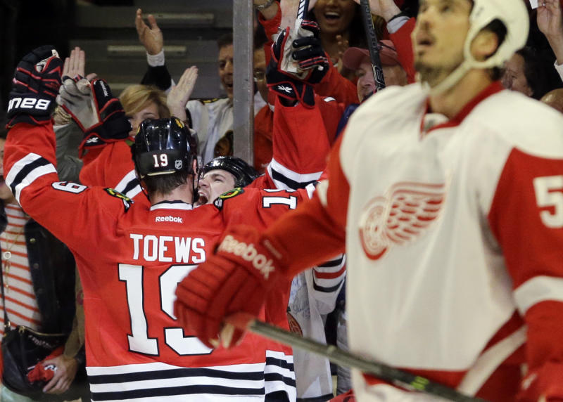 Chicago Blackhawks' Andrew Shaw (65) celebrates with Jonathan Toews (19) after scoring his goal during the second period of Game 5 of the NHL hockey Stanley Cup playoffs Western Conference semifinals against the Detroit Red Wings in Chicago, Saturday, May 25, 2013. (AP Photo/Nam Y. Huh)