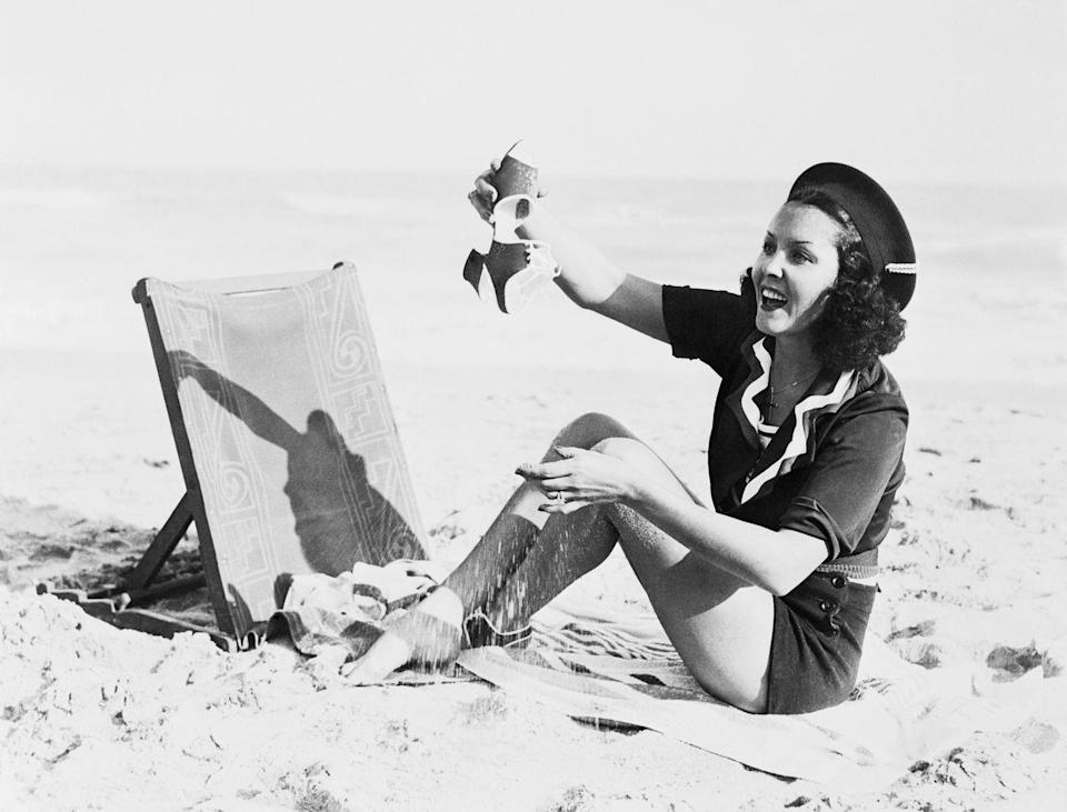 <p>Raquel Torres dumps sand out of her shoe in 1935.</p>