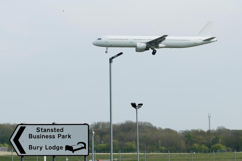 A plane arriving at Stansted Airport (REUTERS)
