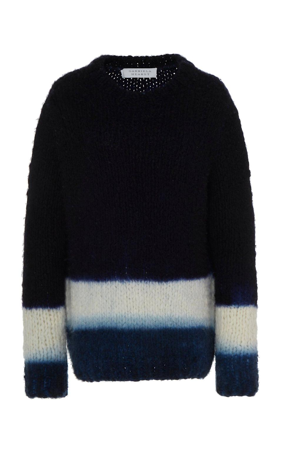 """<p><strong>Gabriela Hearst</strong></p><p>gabrielahearst.com</p><p><strong>$1990.00</strong></p><p><a href=""""https://www.gabrielahearst.com/products/lawrence-dip-dye-sweater-navy-ivory-sapphire?variant=29490105188431"""" rel=""""nofollow noopener"""" target=""""_blank"""" data-ylk=""""slk:Shop Now"""" class=""""link rapid-noclick-resp"""">Shop Now</a></p><p>The Lawrence Dip Dye Sweater in cashmere was made by Manos del Uruguay, a nonprofit that empowers women in Uruguay. As a Latin woman living in New York for the past 20 years, it has informed the perspective that I possess as a creative of these worlds—my native culture and adopted one. My children are born from a first-generation immigrant and proud of it.</p>"""