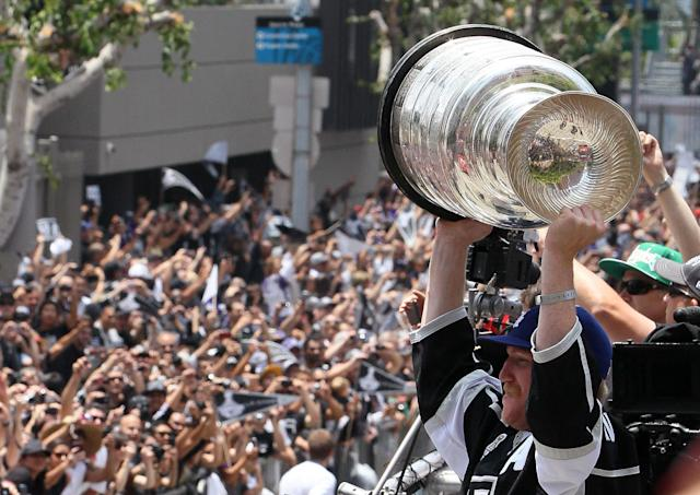 LOS ANGELES, CA - JUNE 14: Matt Greene #2 of the Los Angeles Kings holds up the Stanley Cup to the fans during the Los Angeles Kings Stanley Cup Victory Parade on June 14, 2012 in Los Angeles, California. (Photo by Victor Decolongon/Getty Images)