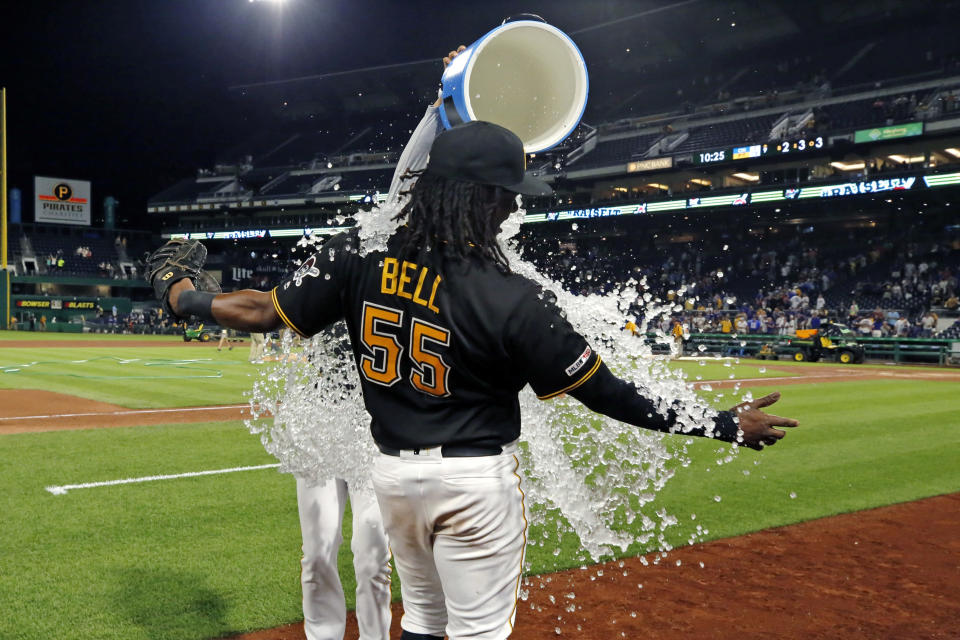 Pittsburgh Pirates' Josh Bell (55) is doused by Chris Archer before he is interviewed after hitting three home runs in an 18-5 win over the Chicago Cubs in a baseball game in Pittsburgh, Monday, July 1, 2019. (AP Photo/Gene J. Puskar)
