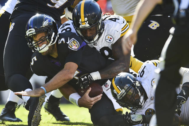 <p>Baltimore Ravens quarterback Joe Flacco (5) is sacked by Pittsburgh Steelers outside linebacker Bud Dupree (48) during the second half of an NFL football game in Baltimore, Sunday, Oct. 1, 2017. The Steelers defeated the Ravens 26-9. (AP Photo/Gail Burton) </p>