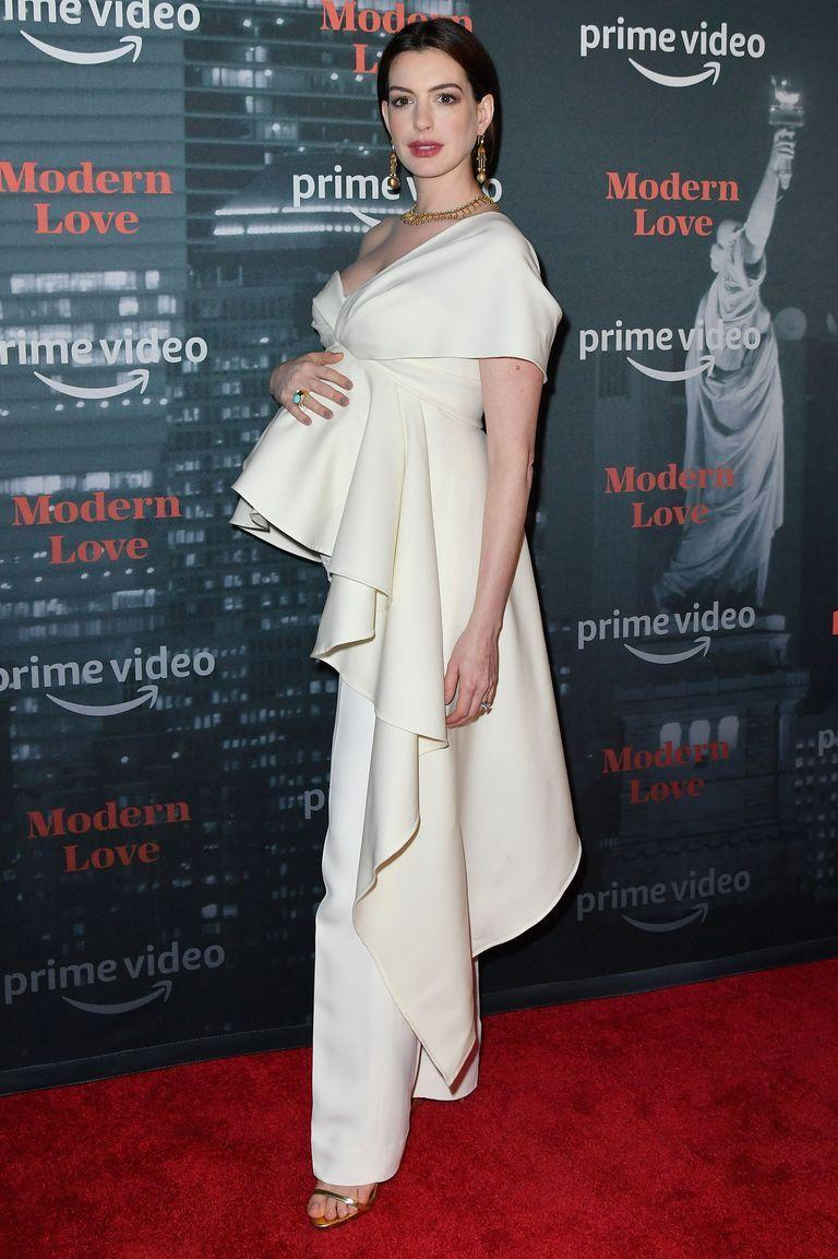 <p>Anne Hathaway opted for pants and a ruffled top that showed off her gorgeous bump at the premiere of <em>Modern Love</em>.</p>