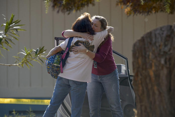 Two school officials embrace on the grounds of the Rancho Tehama Elementary School in Rancho Tehama Reserve in Corning, Calif., on Tuesday, Nov. 14, 2017. (Photo: Randall Benton/Sacramento Bee/TNS via Getty Images)