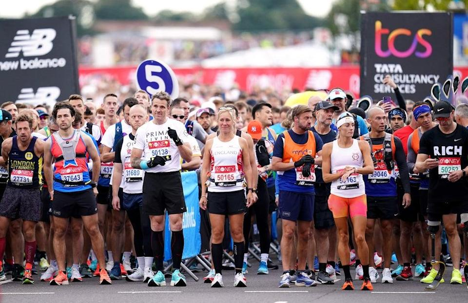 A wave of runners including James Cracknell and Sophie Raworth prepare to start the race (John Walton/PA) (PA Wire)