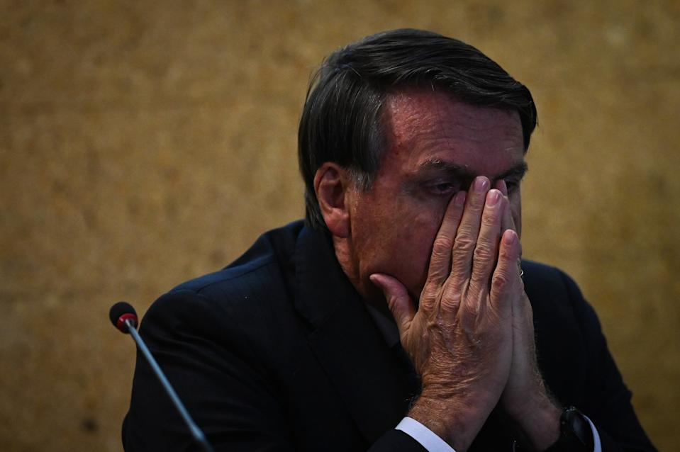 """BRASILIA, BRAZIL - SEPTEMBER 28: Jair Bolsonaro, President of Brazil reacts during the launch ceremony of the """"Mineracao e Desenvolvimento"""" Program on September 28, 2020 in Brasilia, Brazil. The program presents more than a hundred goals and actions for up to 2023 and aims at the quantitative and qualitative expansion of the Brazilian mineral sector and the image of mining with society. (Photo by Andre Borges/Getty Images)"""