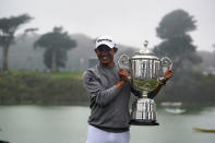 FILE - Collin Morikawa holds the Wanamaker Trophy after winning the PGA Championship golf tournament at TPC Harding Park in San Francisco, in this Sunday, Aug. 9, 2020, file photo. Morikawa tries to join Tiger Woods and Brooks Koepka as repeat winners in stroke play next week at the PGA Championship at Kiawah Island. (AP Photo/Jeff Chiu, File)
