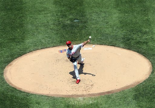 Philadelphia Phillies starting pitcher Cole Hamels throws against the New York Mets in the first inning of a baseball game on Monday, May 28, 2012, at Citi Field in New York. (AP Photo/Kathy Kmonicek)