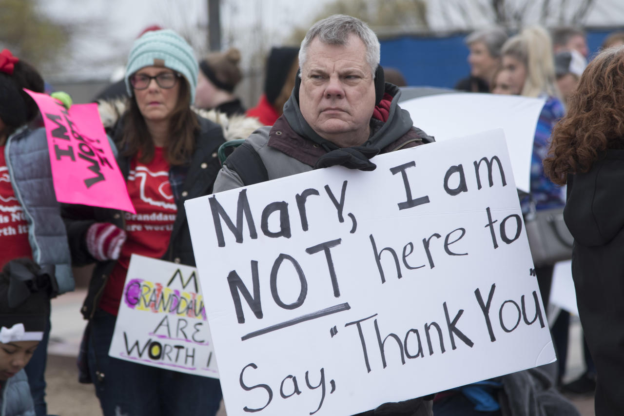 <p>Dennis Gentry holds a protest sign pointedly not thanking Oklahoma Gov. Mary Fallin, who said teachers should come to the Capitol to thank her for a recent raise, during a rally on April 2, 2018, in Oklahoma City. (Photo: J Pat Carter/Getty Images) </p>
