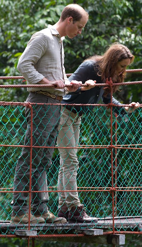 Britain's Prince William, left, and Kate, the Duchess of Cambridge look down on the three-hundred meter in length Canopy Walkway during their visit at the Borneo Rainforest Lodge in Danum Valley, some 70 kilometers (44 miles) west of Lahad Datu, on the island of Borneo Saturday, Sept. 15, 2012. (AP Photo/Mohd Rasfan, Pool)