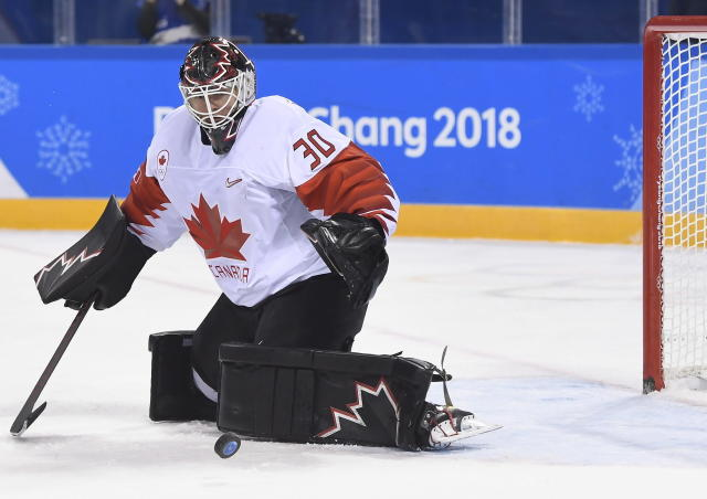 FILE - In this Feb. 15, 2018, file photo, Canada goaltender Ben Scrivens makes a save against Switzerland during second period men's hockey action at the 2018 Olympic Winter Games in Pyeongchang, South Korea. Scrivens keeps trying to figure out what hes doing wrong. And it has nothing to do with playing hockey. Every once in a while in the Kontinental Hockey League, the Canadian-born former NHL goaltender offends someone and has to figure out what Russian superstition or custom he broke. There are plenty. (Nathan Denette/The Canadian Press via AP)
