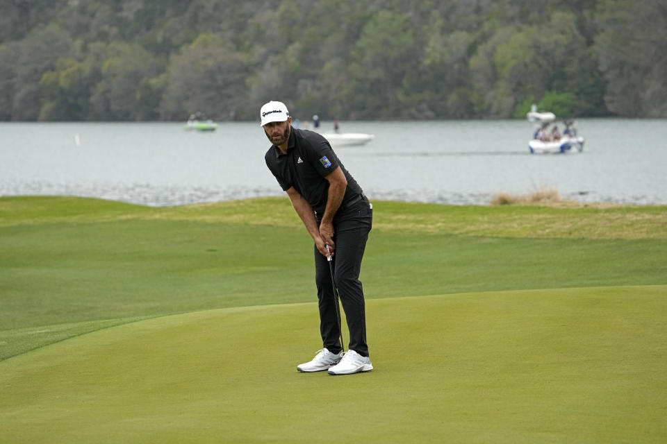 Dustin Johnson watches as he misses a birdie put on the 14th green during a first round match at the Dell Technologies Match Play Championship golf tournament Wednesday, March 24, 2021, in Austin, Texas. (AP Photo/David J. Phillip)