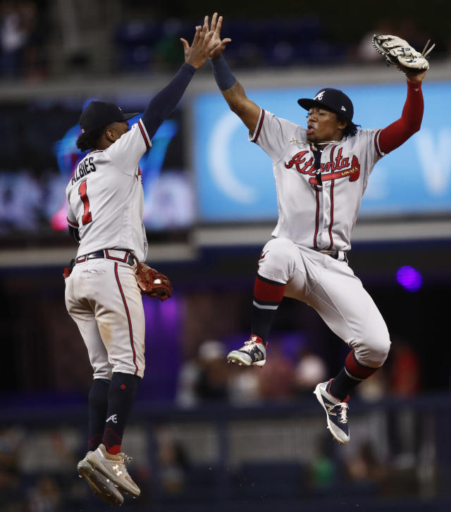Atlanta Braves' Ozzie Albies, left, and Ronald Acuna Jr. celebrate the team's 8-4 win over the Miami Marlins in a baseball game Friday, Aug. 9, 2019, in Miami. (AP Photo/Brynn Anderson)