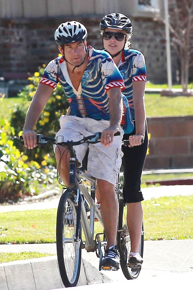"The couple who bikes together stays together ... Jerry O'Connell and Rebecca Romijn were spotted out on a tandem bike ride near their L.A. home Tuesday sporting matching garish tops. Do you think they lost a bet? Sam Sharma/<a href=""http://www.pacificcoastnews.com/"" target=""new"">PacificCoastNews.com</a> - January 18, 2011"