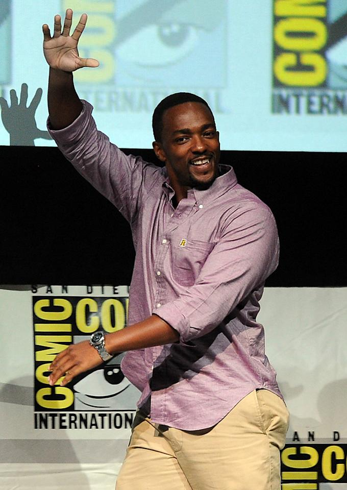 "SAN DIEGO, CA - JULY 20:  Actor Anthony Mackie speaks onstage at Marvel Studios ""Thor: The Dark World"" and ""Captain America: The Winter Soldier"" during Comic-Con International 2013 at San Diego Convention Center on July 20, 2013 in San Diego, California.  (Photo by Kevin Winter/Getty Images)"
