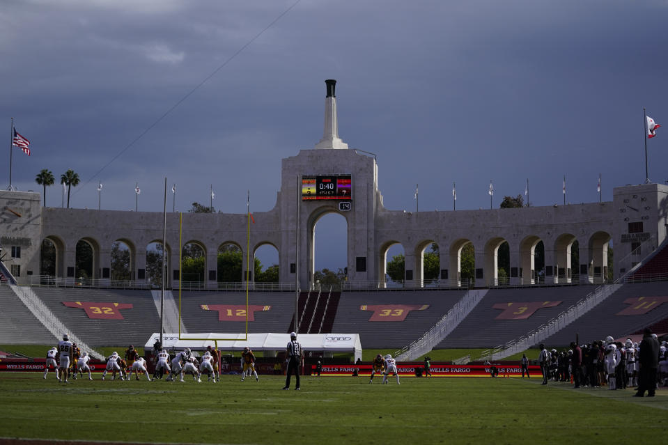 Rain clouds move through the area of Los Angeles Memorial Coliseum during the first half of an NCAA football game between Arizona State and Southern California on Nov 7. (AP)
