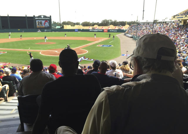 FILE - In this March 5, 2016, file photo, Tommy Giordano, right foreground, special assistant to the general manager of the Atlanta Braves, scouts a spring training baseball game between the Braves and the Pittsburgh Pirates, in Kissimmee, Fla. Tommy Giordano is dying. But do not let your heart be heavy. Hes going out like he lived for more than 93 years _ surrounded by family and friends, accompanied by overwhelming love and stories that will endure long after hes gone. (AP Photo/Paul Newberry, File)