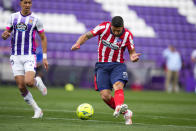 Atletico Madrid's Luis Suarez shoots the ball to score his side's second goal during the Spanish La Liga soccer match between Atletico Madrid and Valladolid at the Jose Zorrilla stadium in Valladolid, Spain, Saturday, May 22, 2021. (AP Photo/Manu Fernandez)