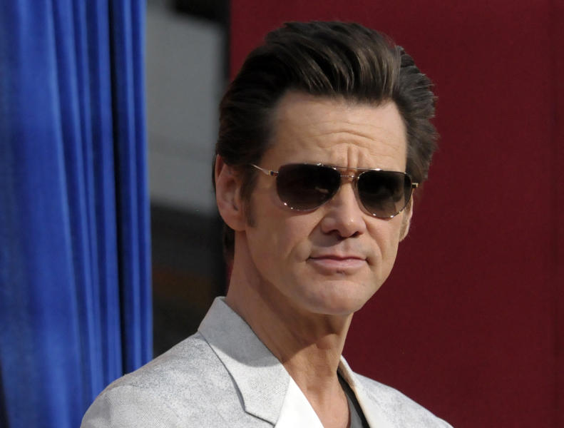 """FILE - This March 11, 2013 file photo shows actor Jim Carrey at the world premiere of """"The Incredible Burt Wonderstone"""" at the TCL Chinese Theatre in Los Angeles. Carrey says that he """"cannot support"""" the violence in his upcoming superhero action flick """"Kick-Ass 2"""" in the wake of the Sandy Hook Elementary School massacre. The actor tweeted Sunday, June 23, that, after shooting the film last year before the Connecticut tragedy, """"now in good conscience I cannot support that level of violence."""" Carrey added that he wasn't ashamed of the film """"but recent events have caused a change in my heart."""" """"Kick-Ass 2"""" is a sequel to the 2010 action comedy whose breakout star was the 11-year-old vigilante Hit-Girl, played by Chloe Grace Moretz. She reprises the role in the sequel, which Universal Pictures will release August 16. Carrey plays an upstart, superhero-costume wearing vigilante named Colonel Stars and Stripes. (Photo by Dan Steinberg/Invision/AP, file)"""