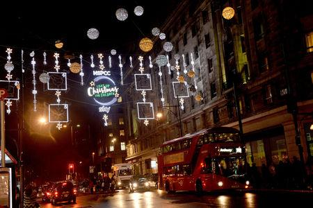 FILE PHOTO - A bus passes the Oxford Street Christmas lights, in London