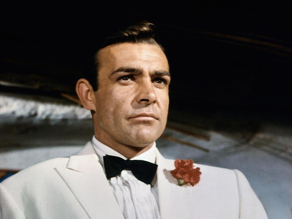 <p>Style and substance: as the secret agent in 1964's 'Goldfinger'</p> (Bettmann Archive via Getty)