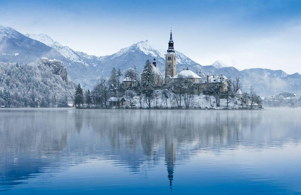 <p>A church and castle on a rock above Lake Bled in Slovenia.</p>