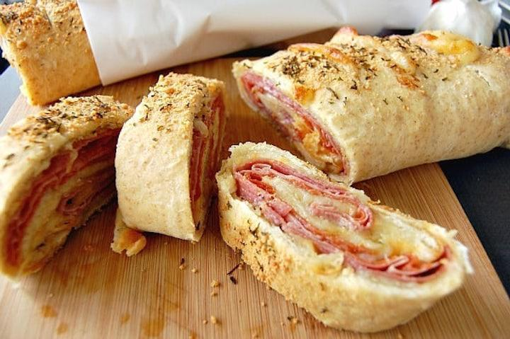 """<p>Ham and cheese is a classic combination. Go beyond your basic lunchtime sandwich with this baked stromboli recipe.</p> <p><a href=""""https://www.thedailymeal.com/easy-ham-and-cheese-stromboli?referrer=yahoo&category=beauty_food&include_utm=1&utm_medium=referral&utm_source=yahoo&utm_campaign=feed"""" rel=""""nofollow noopener"""" target=""""_blank"""" data-ylk=""""slk:For the Ham and Cheese Stromboli recipe, click here."""" class=""""link rapid-noclick-resp"""">For the Ham and Cheese Stromboli recipe, click here.</a></p>"""