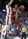 Alabama's Collin Sexton, right, heads to the basket as Auburn's Horace Spencer defends during the second half in an NCAA college basketball quarterfinal game at the Southeastern Conference tournament Friday, March 9, 2018, in St. Louis. Alabama won 81-63. (AP Photo/Jeff Roberson)