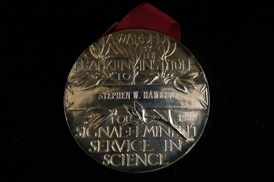 The Franklin Medal awarded to Professor Stephen Hawking which has been acquired by the Science Museum Group, in London, Wednesday, May 26, 2021. Science Museum Group and Cambridge University Library will announce that they have acquired the historic contents of Professor Stephen Hawking's office (going to SMG) and his archive (going to CUL). (AP Photo/Kirsty Wigglesworth)