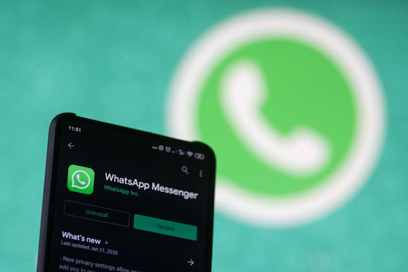 WhatsApp logo displayed on a phone screen, smartphone and keyboard are seen in this multiple exposure illustration. WhatsApp Messenger is a multiplatform mobile application that provides an encrypted instant messaging system belonging to Facebook, photo taken in Amsterdam, Netherlands on January 28, 2020 (Photo illustration by Nicolas Economou/NurPhoto)