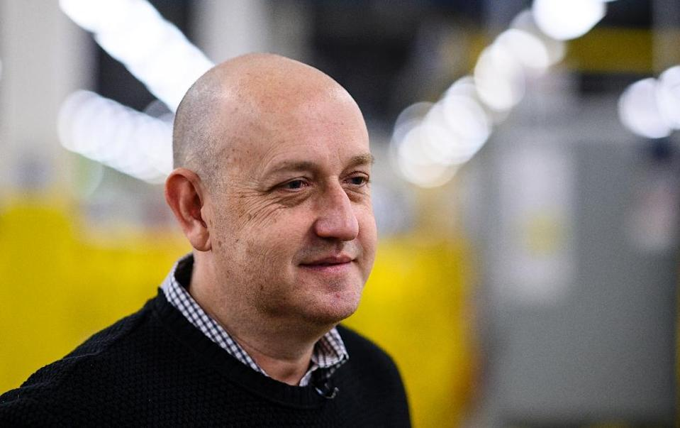 Tye Brady, chief technologist for Amazon Robotics, has worked in the field for three decades (AFP Photo/Johannes EISELE)